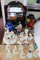 Collection of eleven Disney Showcase figures, shelf stand, Poole dolphin, vases, inlaid boxes, etc.