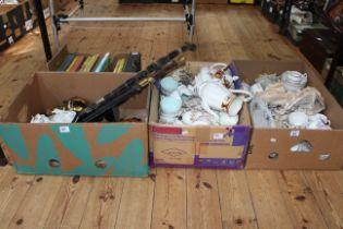 Four boxes of teaware including Royal Albert, children's annuals, bisque plaque, oil lamp, etc.
