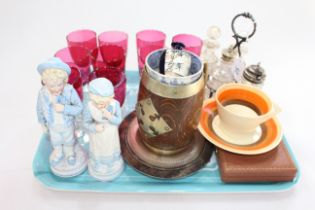 Nine Cranberry glasses, four bottle cruet, pair Continental figures, Clarice Cliff cup and saucer,