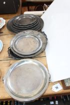 Fourteen pieces of pewter including various size plates, dishes, etc.