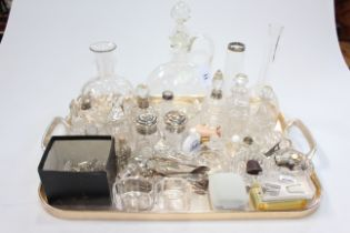 Collection of glassware with some silver topped bottles, thimbles, etc.
