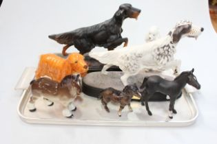Two Beswick 'Setter' sculptures and five other dog and horse ornaments (7).