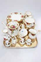 Royal Albert Country Roses tableware, thirty eight pieces including teapot, sugar and cream.
