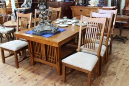 Oak Arts & Crafts style eight piece dining suite comprising two door sideboard,