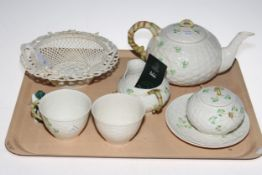 Belleek seven piece tea for two, basket work bowl and small bell.