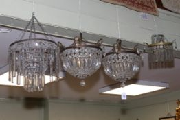 Collection of four lustre drop light fittings including a pair of circular fittings.