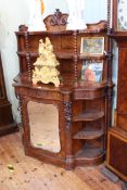 Victorian figured walnut side cabinet having shelf back with twist supports above a shaped front