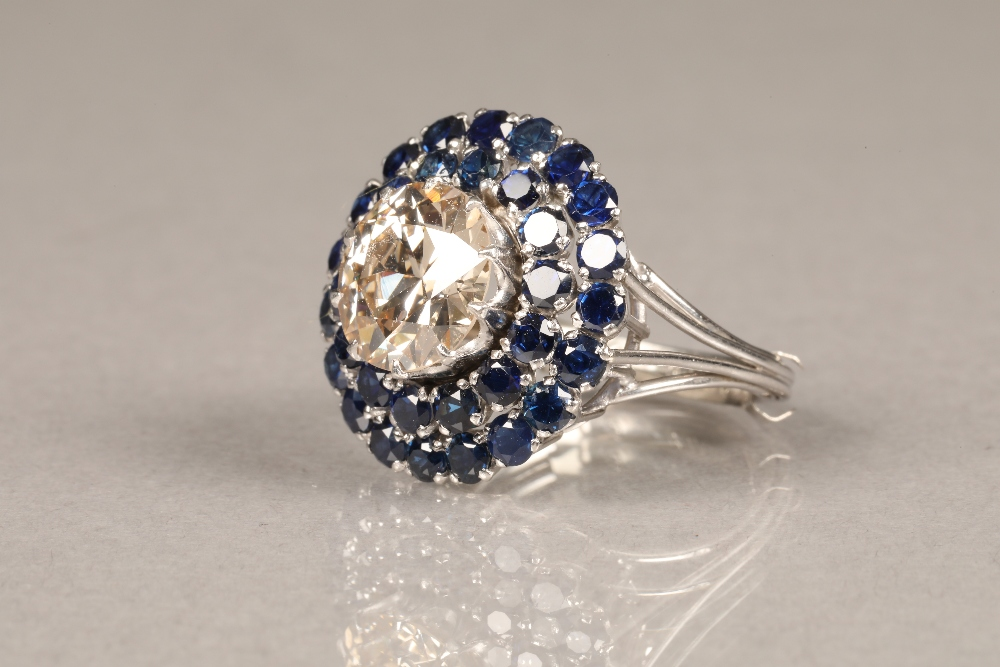 A diamond and sapphire three tiered circular cluster ring, centrally set with brilliant cut - Image 6 of 6