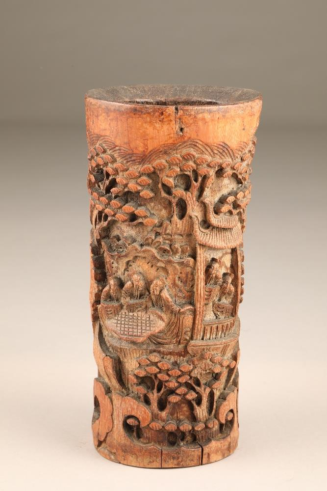 Chinese hand carved bamboo brush pot, figures, pagodas and pine trees, 27cm high.
