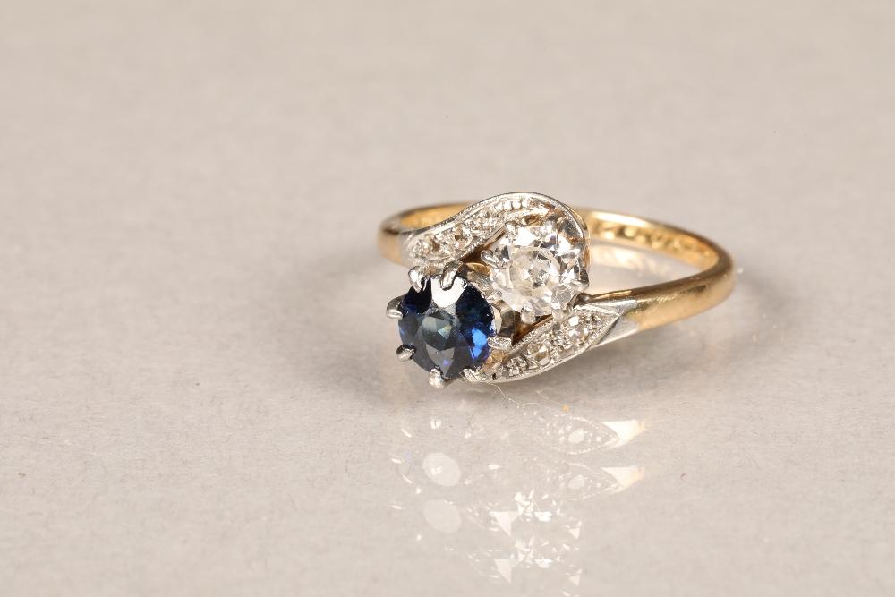 Ladies 18 carat gold diamond and sapphire ring, 0.33 diamond and 0.5 sapphire in twist setting,