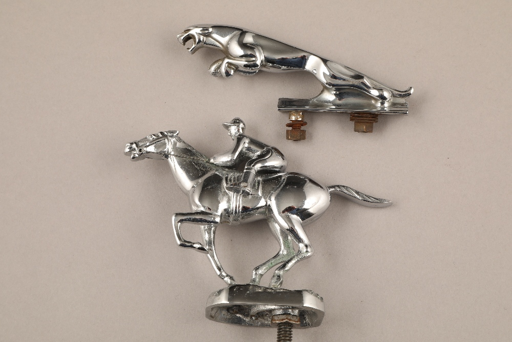 Automobilia - a chrome Jaguar mascot, 13cm long and a chrome car mascot in the form of a jockey on a