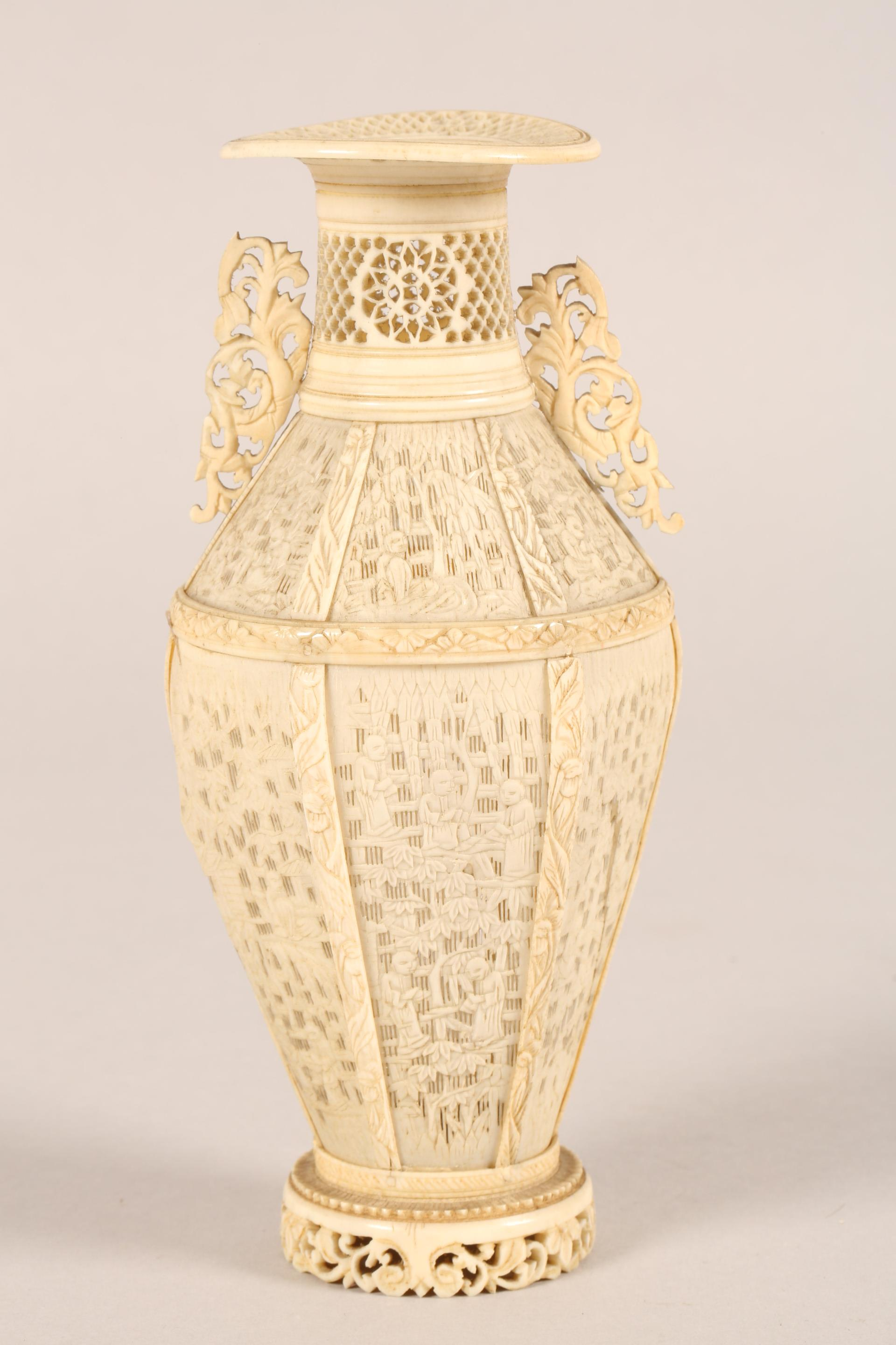 19th century Chinese Canton reticulated ivory twin handled vase (minor damages) 17.5cm high. - Image 7 of 7