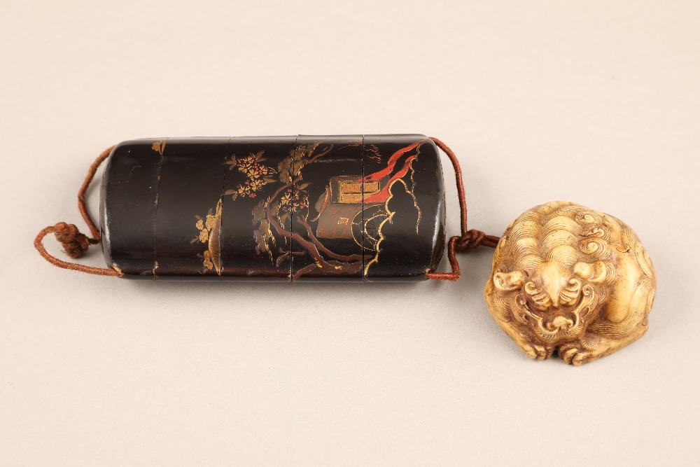 Japanese four case black lacquer inro, gilt decoration together with a carved ivory buddhist dog