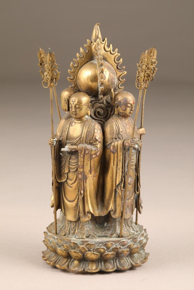 Chinese gilt bronze figure group of four Buddhist monks, standing with their backs to a flaming - Image 2 of 5