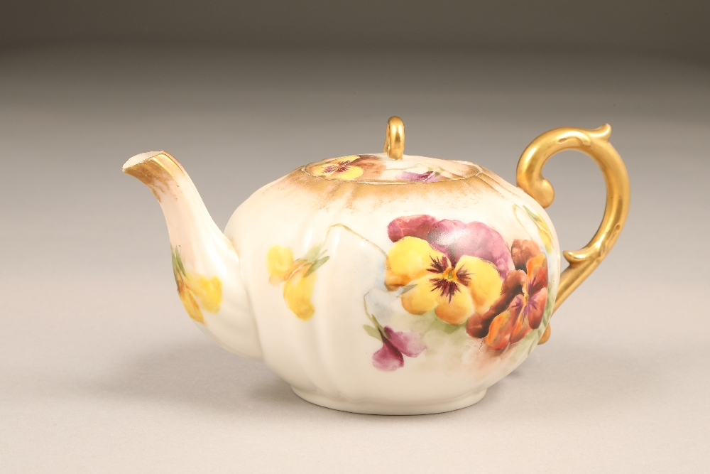 Nautilus porcelain teapot, gilt scroll teapot, hand painted in pansies.