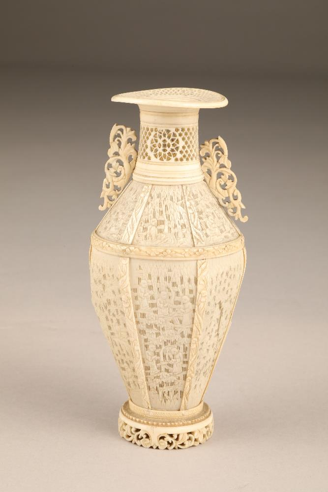19th century Chinese Canton reticulated ivory twin handled vase (minor damages) 17.5cm high.