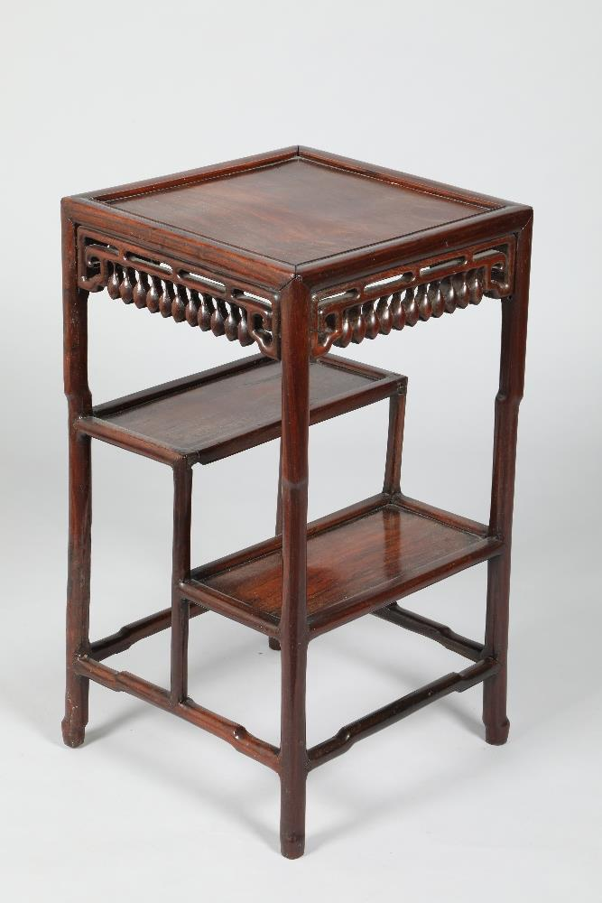 Chinese hardwood jardinière stand, square topped, pierced and carved apron, raised on four legs
