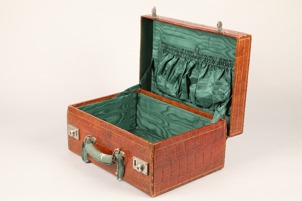 A fine crocodile leather suitcase, with an outer protective cover and green lining. 46cm long, - Image 2 of 2