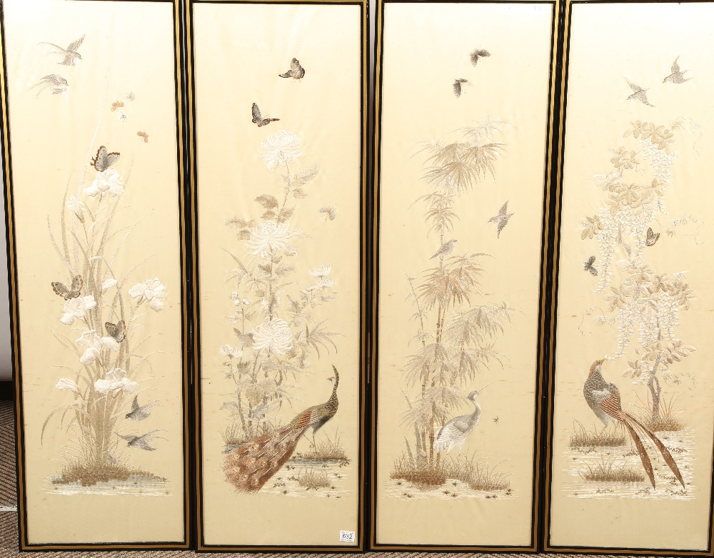 Set of four Japanese framed silk works depicting assorted flowers, bamboo with birds and