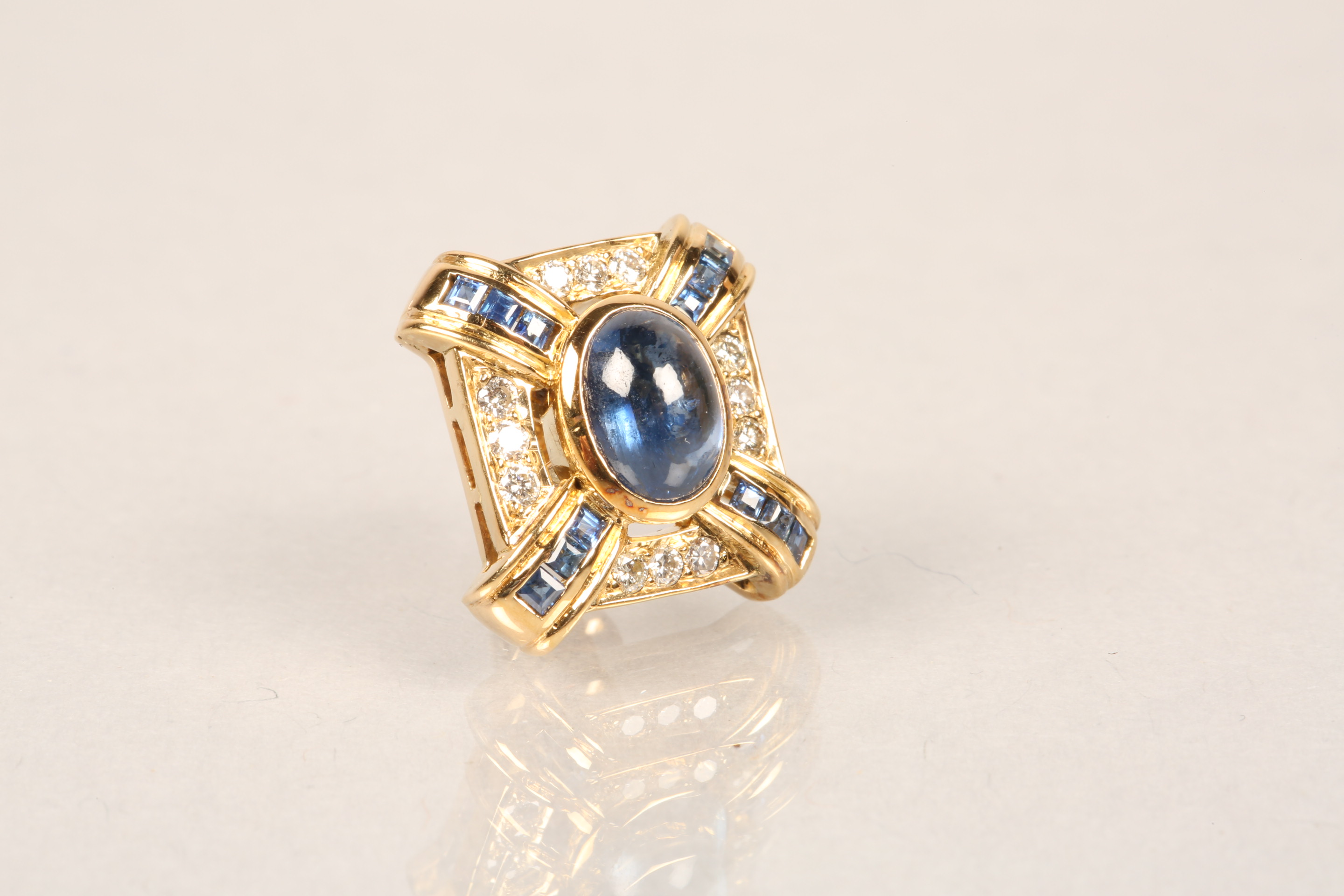 Boxed pair of 18 carat gold earrings, each set with a central blue sapphire cabochon surrounded by - Image 4 of 6