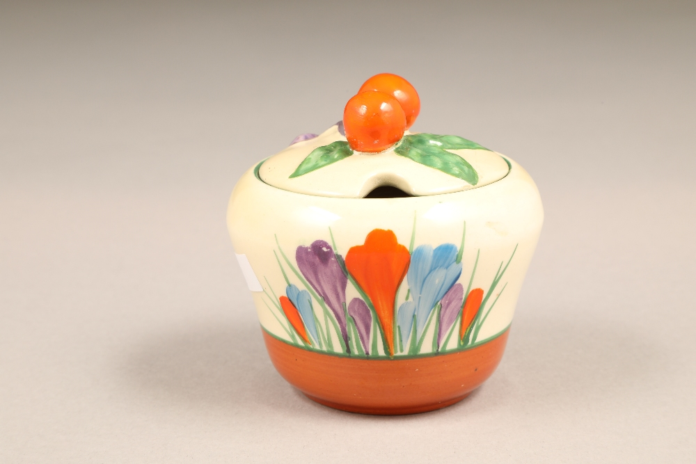 A Clarice Cliff Bizarre crocus pattern preserve pot and cover, with printed mark, 7.5cm high. - Image 3 of 5