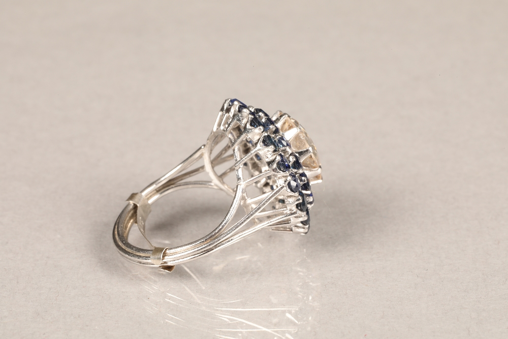 A diamond and sapphire three tiered circular cluster ring, centrally set with brilliant cut - Image 4 of 6