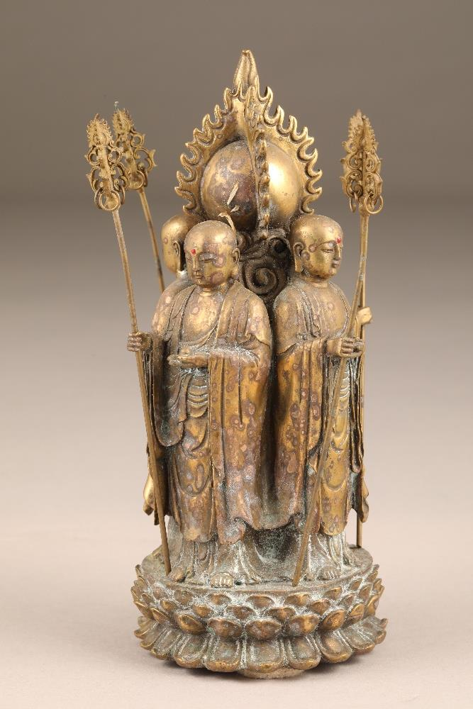 Chinese gilt bronze figure group of four Buddhist monks, standing with their backs to a flaming - Image 3 of 5