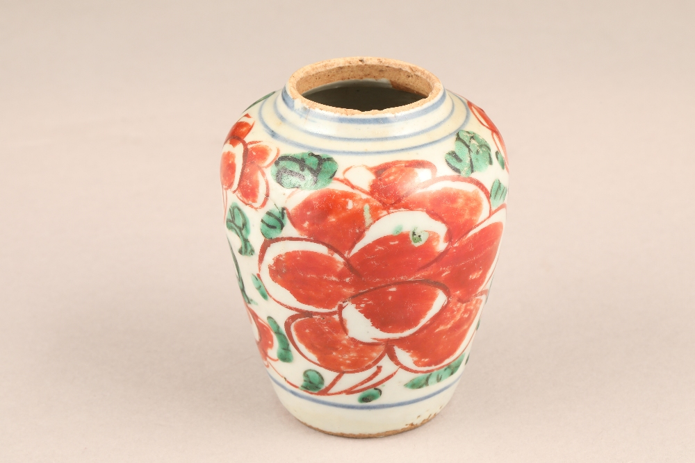 17th century Chinese pottery vase, baluster form, decorated with iron red flowers and green