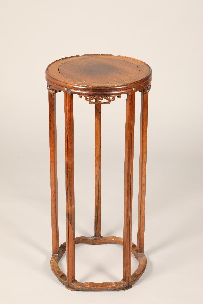 Pair Chinese hardwood jardinière stands, circular tops supported on five legs united by base