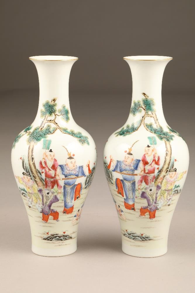 Pair 19th/20th century Chinese vases, of baluster form decorated with children playing with a sword,