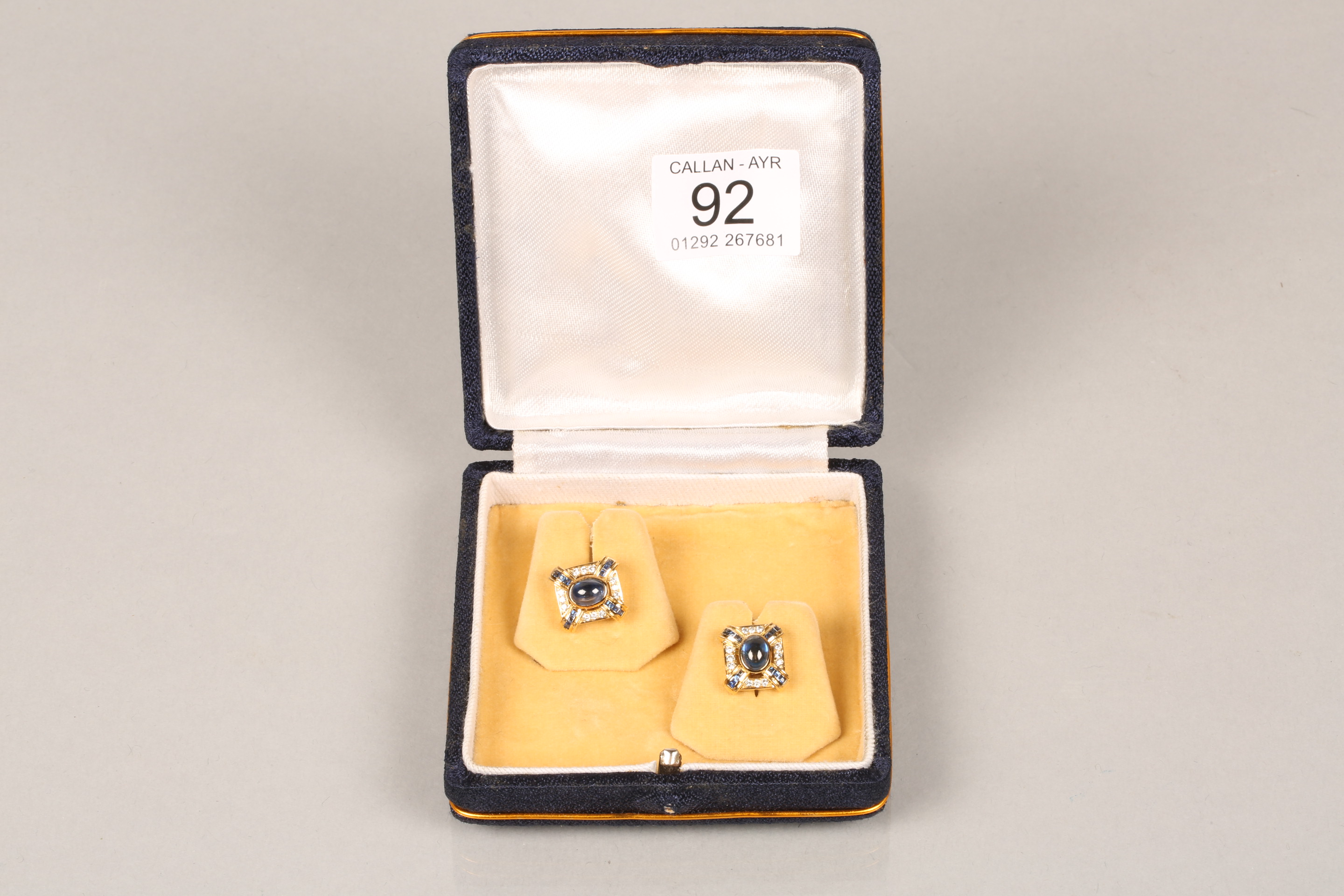 Boxed pair of 18 carat gold earrings, each set with a central blue sapphire cabochon surrounded by - Image 6 of 6