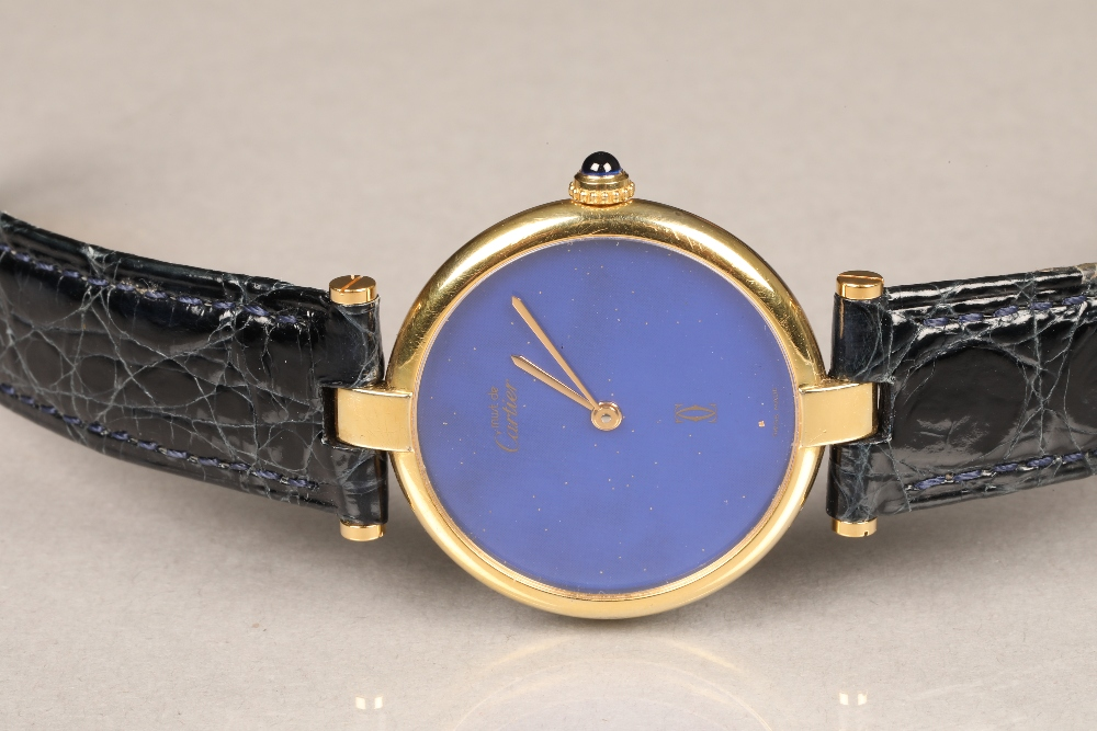 Must De Cartier silver gilt wrist watch, with blue dial, gilt hands, sapphire crown, and with