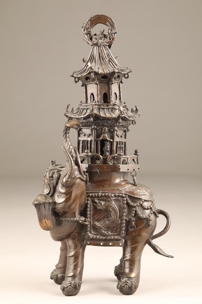 20th century oriental bronze elephant, formed as an elephant with trunk up and a howdah placed on