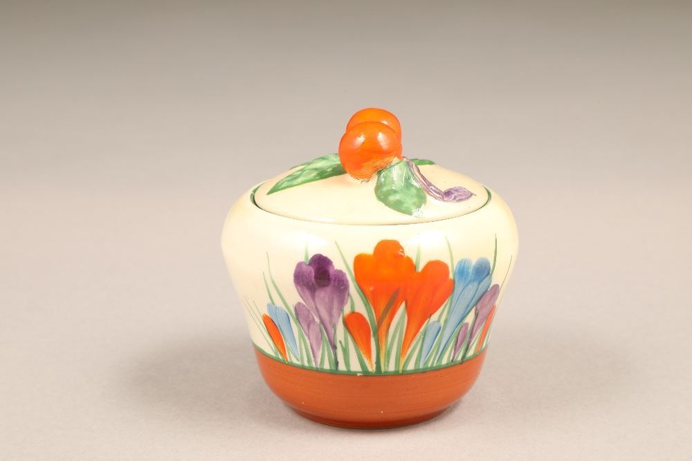 A Clarice Cliff Bizarre crocus pattern preserve pot and cover, with printed mark, 7.5cm high.