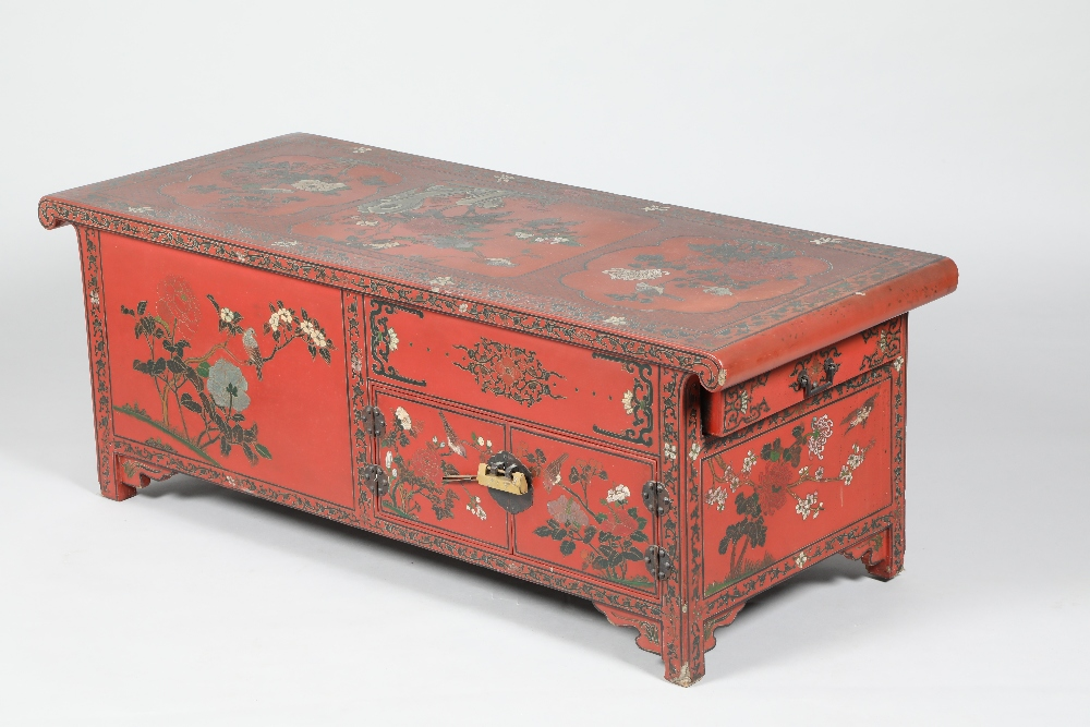A Chinese lacquered opium table cabinet, 127cm long, 51cm wide, 46.5cm high.