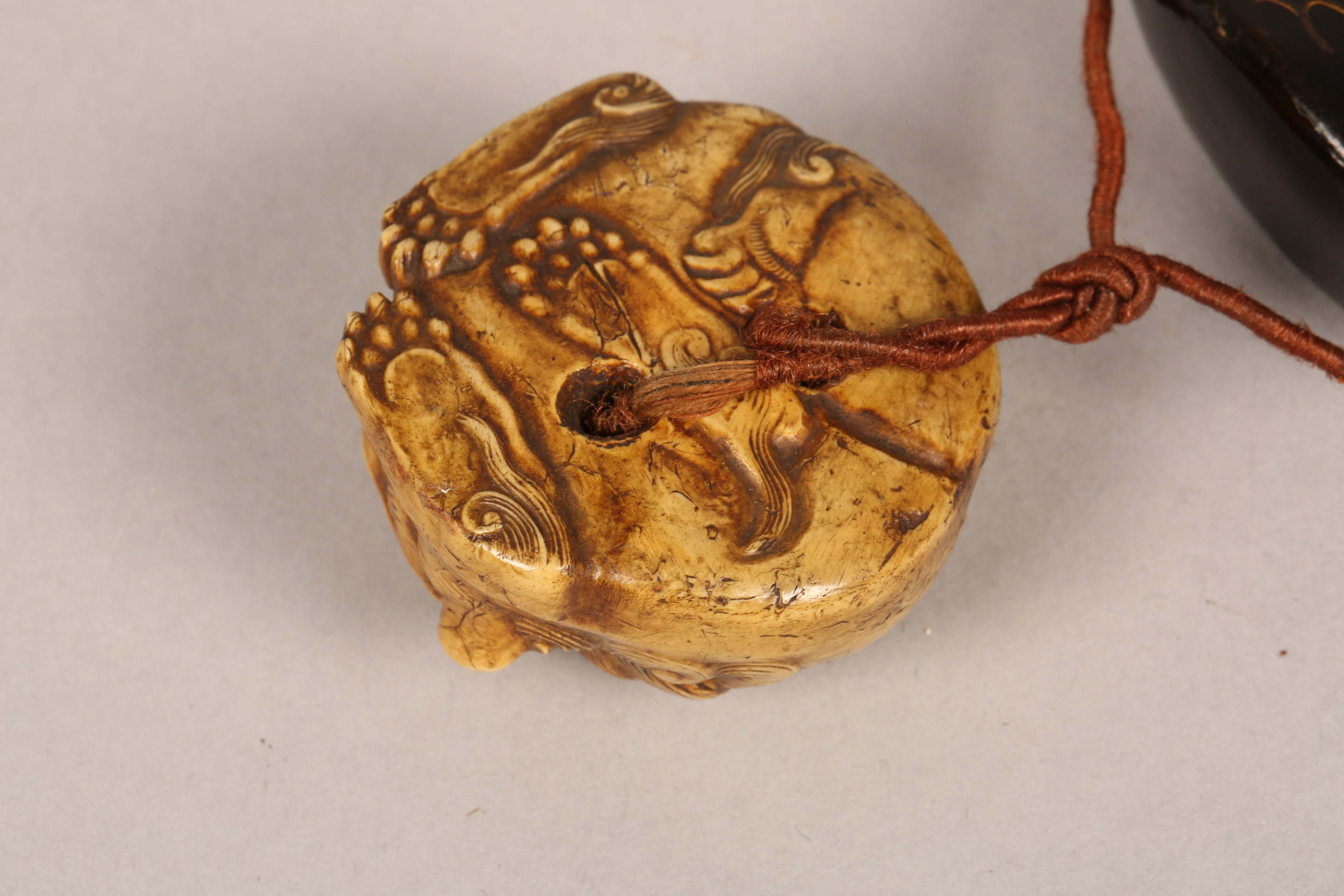 Japanese four case black lacquer inro, gilt decoration together with a carved ivory buddhist dog - Image 8 of 9
