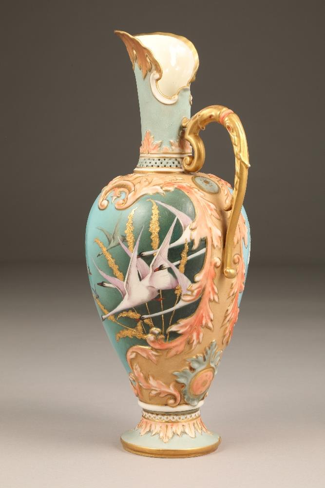 Fine Nautilus porcelain ewer, baluster form with a gilt scroll acanthus leaf handle, painted in