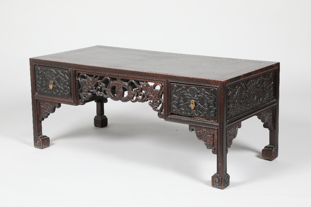 Pair Chinese hardwood low tables, pierced and carved frieze between two single fitted drawers,