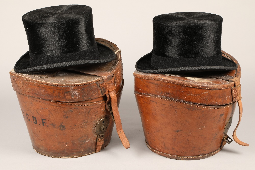 Black top hat by Battersby & Co London with a travel case plus another black top hat by Lock & Co,