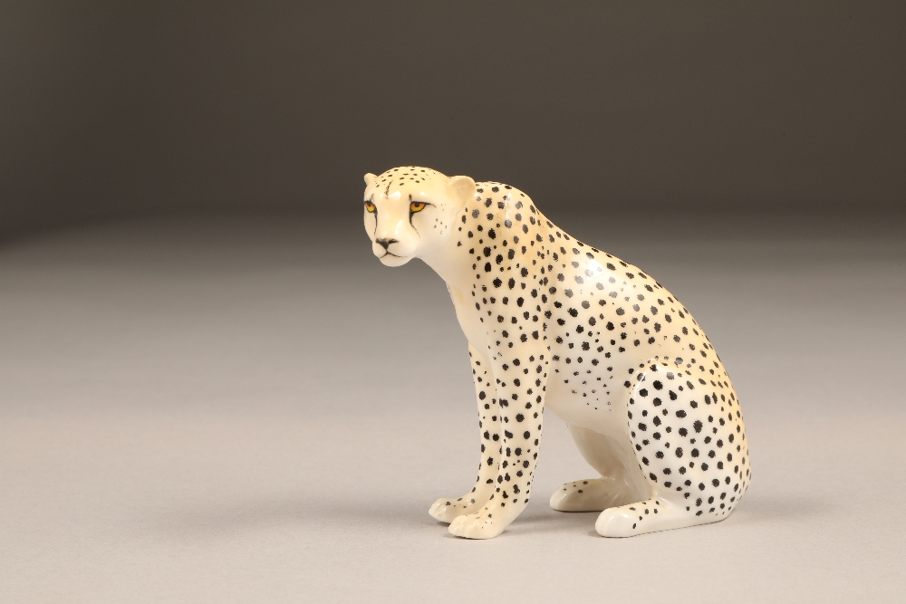 Royal Worcester porcelain cheetah figure ornament, 9.5cm high.