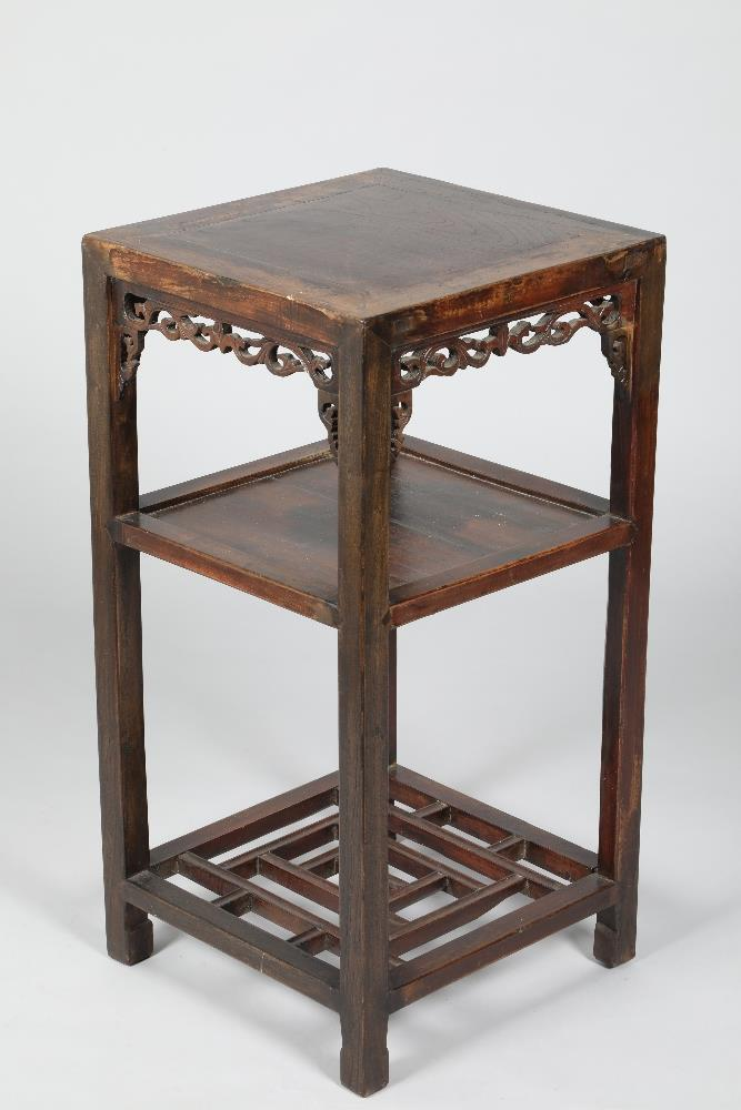 Chinese hardwood jardinière stand, square top, carved and pierced apron, four legs united by an
