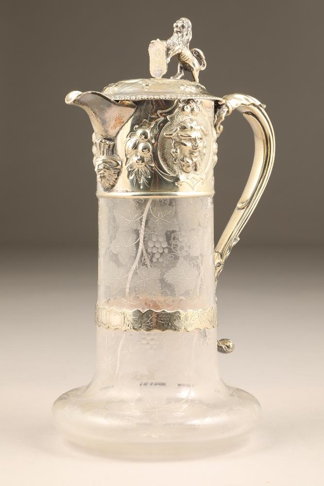 Victorian electro plated silver mounted glass decanter, scroll handle, lion and shield finial,