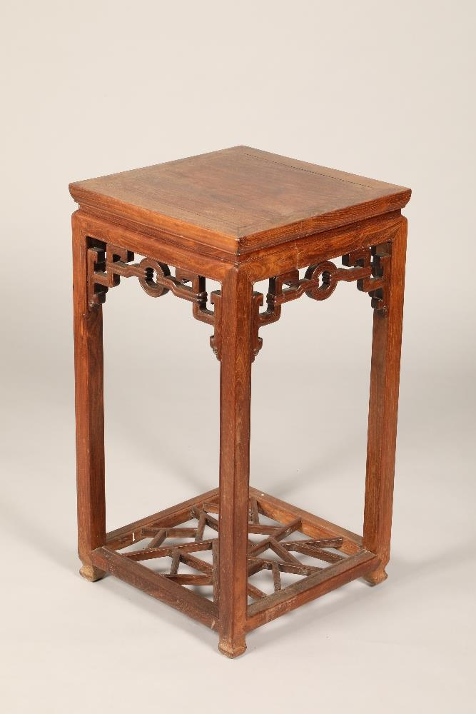 Chinese hardwood jardiniere stand, square topped raised on four legs united by cross stretchers,