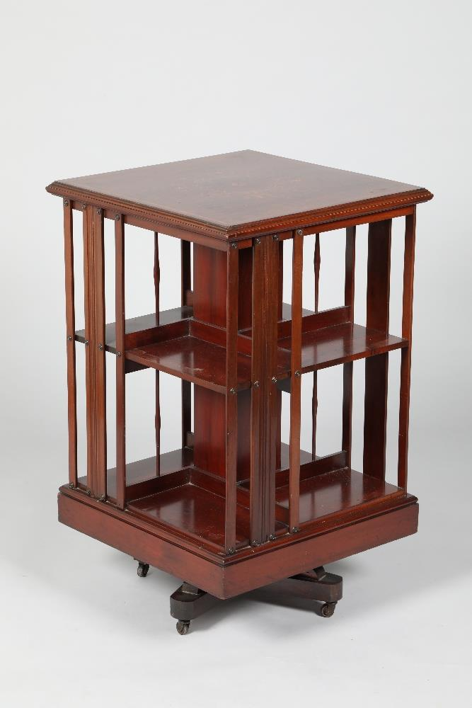 A Victorian inlaid rosewood revolving bookcase, 82cm high, 51cm deep, 51cm long.