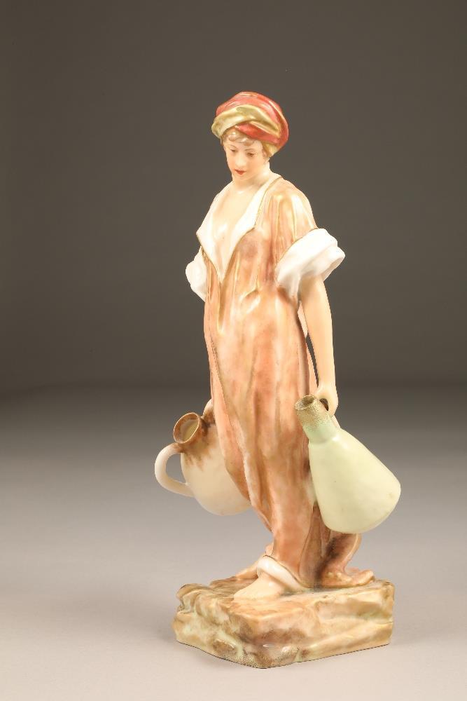 Nautilus porcelain figure, the water carrier, 35.5cm high.