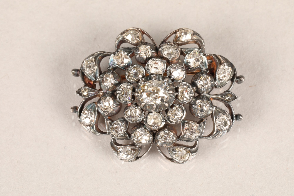 Diamond pierced cluster brooch, thirty one old cut diamonds mounted on heavily tarnished yellow