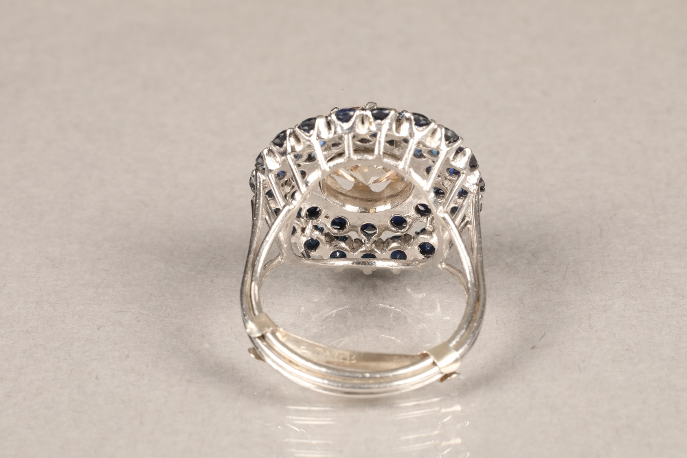 A diamond and sapphire three tiered circular cluster ring, centrally set with brilliant cut - Image 3 of 6
