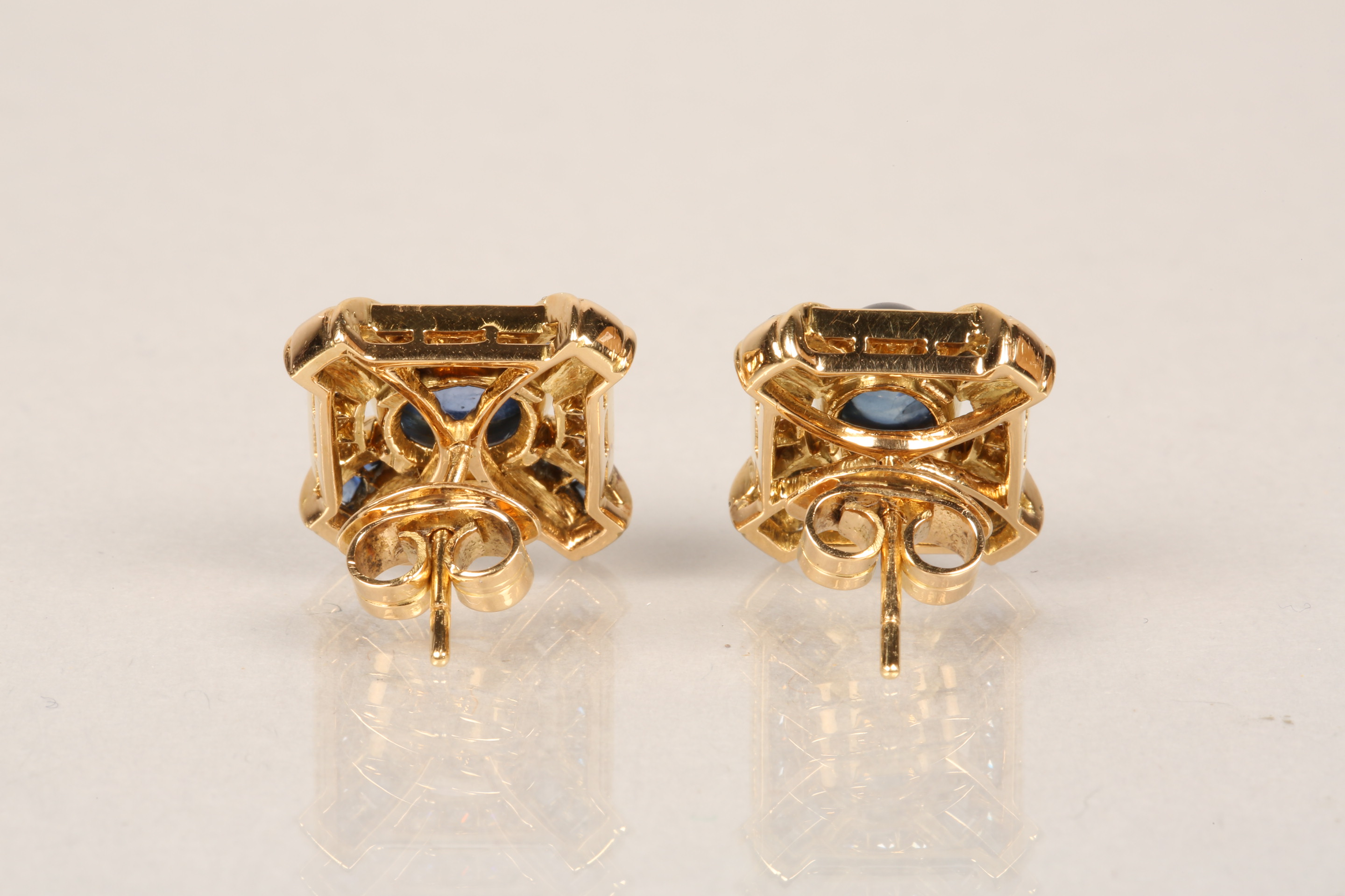 Boxed pair of 18 carat gold earrings, each set with a central blue sapphire cabochon surrounded by - Image 5 of 6