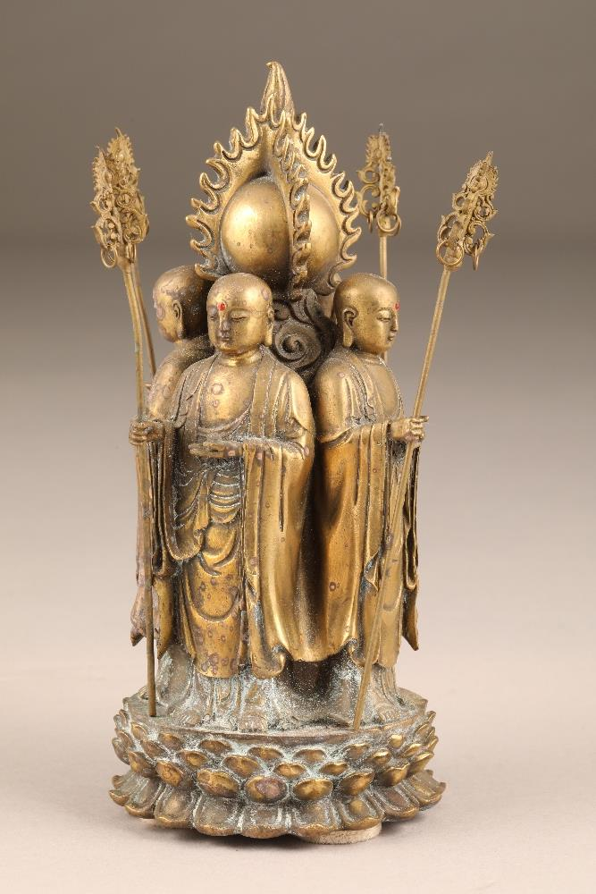 Chinese gilt bronze figure group of four Buddhist monks, standing with their backs to a flaming - Image 4 of 5