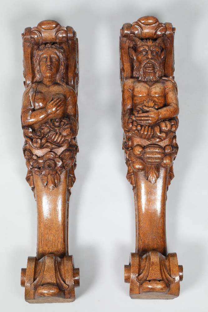 Pair 19th century oak caryatids, of baroque style, one depicting a satyr, the other a bacchante,